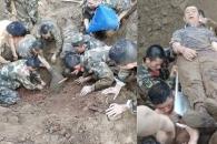 中공사장 매몰 사고…경찰, 맨 손으로 땅 파 인부 구조